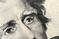 Eye on your money. Closeup of currency detailing eyes Royalty Free Stock Photos