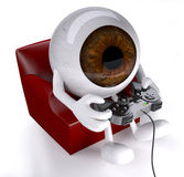 Eyeball on armchair with arms, legs and game controller Stock Photo