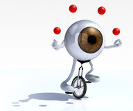 Eyeball with arms and legs rides a unicycle Royalty Free Stock Images