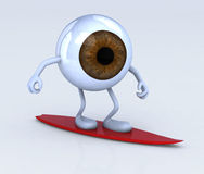 Eyeball with arms and legs on surf board Stock Photos