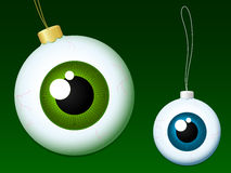 Eyeball christmas baubles. Green and blue royalty free illustration