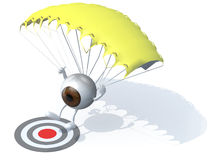 Eyeball that is landing with parachute on a targe Royalty Free Stock Images