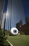 Eyeball and skyscrapers. Big eyeball sculpture and skyscrapers in Dallas, Texas Stock Images