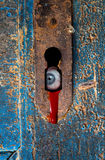 Eyeball staring through rusty keyhole. Eyeball staring through old rusty keyhole Royalty Free Stock Image
