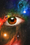 Eyeball Universe Background. Giant eyeball starscape backdrop with colorful space clouds Stock Images