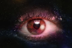 Eyeball Universe Background. Giant eyeball starscape backdrop with colorful space clouds Royalty Free Stock Image