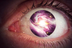 Eyeball Universe. Giant eyeball backdrop with colorful space clouds universe pupil Royalty Free Stock Photography