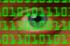 Eyeball watching digital binary code Stock Photos