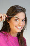 Eyebrow. Close up of lady applying eyebrow make up royalty free stock photo