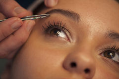 Eyebrow beauty. Young woman in beauty spa Stock Photo