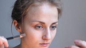 Eyebrow combing close up stock video