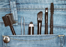 Eyebrow grooming tools in jeans pocket Stock Images