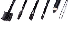 Eyebrow grooming tools on white background Royalty Free Stock Photography