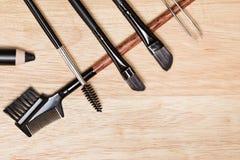 Eyebrow grooming tools on wood background Stock Photos