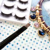 Eyebrow pencil and false lashes. Eyebrow pencil and cosmetics, false lashes Stock Image