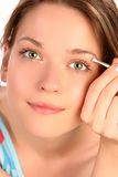 Eyebrow plucking Royalty Free Stock Image