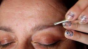 Eyebrow shaping HD stock video footage