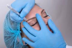 Eyebrow tattoo Royalty Free Stock Image