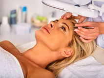 Eyebrow treatment of woman middle-aged in spa salon. Stock Images