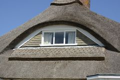 Eyebrow window in thatched roof Royalty Free Stock Image