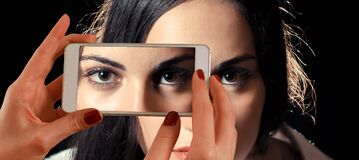 Eyebrow of Woman Taken Shot by White Smartphone Inside Well Lighted Room Stock Photos