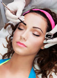 Eyebrows tinting. Treatment with natural henna dye Royalty Free Stock Image