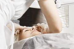 Eyebrows tweezing Stock Photo