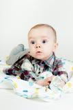 Eyed astonished baby. Funny cute blue-eyed baby. Little boy astonished royalty free stock image