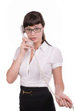 Eyed girl with a telephone receiver Stock Image