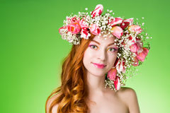 Eyed redhead girl with bright makeup and a wreath of spring flow Stock Images