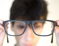 Eyeglasees near eyes. On white Royalty Free Stock Photography