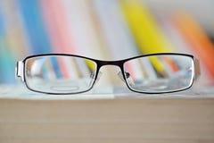 Eyeglass on book Royalty Free Stock Image