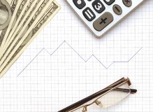 Eyeglass, calculator and the working paper Royalty Free Stock Image