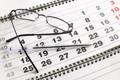 Eyeglass on calendar Royalty Free Stock Image