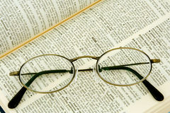 Eyeglass and dictionary Royalty Free Stock Photo
