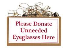 Eyeglass Donation Box. Box full of unneeded glasses ready for donation.  Isolated on white.  Studio shot.  Horizontal shot Royalty Free Stock Photos