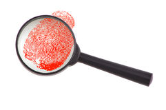 Eyeglass and fingerprint. Photograph of eyeglass and fingerprint in red royalty free stock images