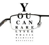 Eyeglass with humorous eyetest chart Royalty Free Stock Photos