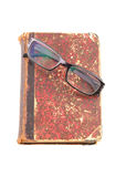 Eyeglass on old book isolated Stock Image