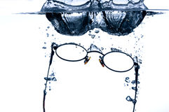 Eyeglass splashing in wate Royalty Free Stock Image