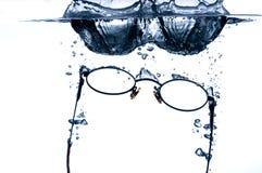 Eyeglass splashing in wate Royalty Free Stock Image