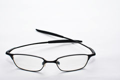 Eyeglass with white background. A shot of eyeglass with white background Stock Photo