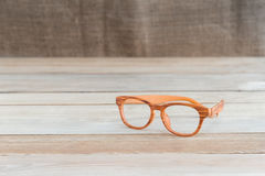 Eyeglass on wood table Royalty Free Stock Images