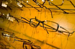 Eyeglasse frames on wall display Royalty Free Stock Images