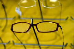 Eyeglasse frames on wall display Royalty Free Stock Photo