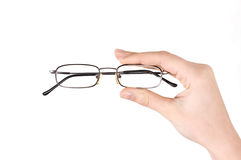 eyeglasses εκμετάλλευση χεριών Στοκ φωτογραφία με δικαίωμα ελεύθερης χρήσης