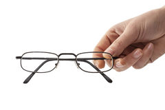 Eyeglasses εκμετάλλευσης χεριών γυναικών στοκ φωτογραφίες