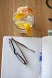 Eyeglasses на тетради Стоковые Изображения