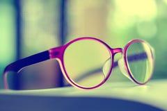 Eyeglasses помещенные на книге Стоковая Фотография RF