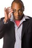 eyeglasses держа человека Стоковые Фотографии RF